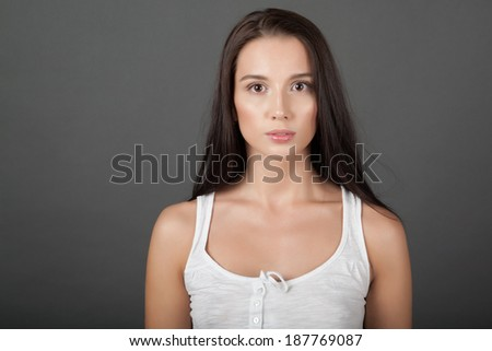 Portrait of a woman on gray background - stock photo