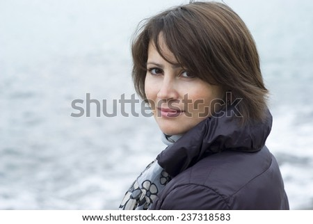 Portrait of a woman posing for the camera, outdoor - stock photo
