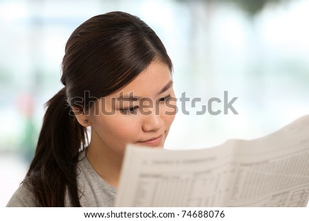 Portrait of a woman reading - stock photo