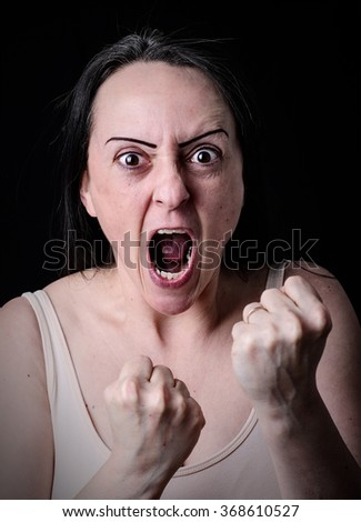 Portrait of a woman ready to fight with fists up. - stock photo