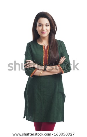 Portrait of a woman standing with her arms crossed - stock photo