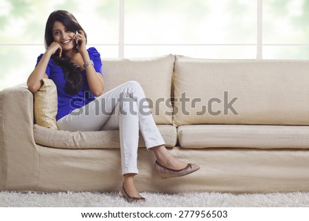 Portrait of a woman talking on a mobile phone - stock photo