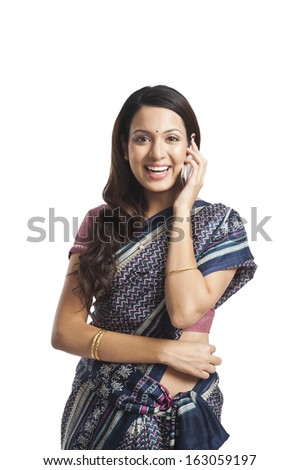 Portrait of a woman talking on a mobile phone and smiling - stock photo