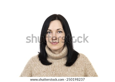 portrait of a woman wearing beige sweater posing isolated over white  - stock photo