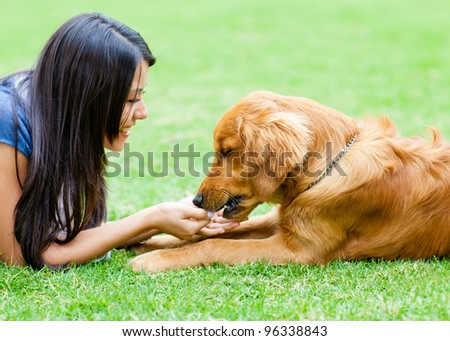 Portrait of a woman with a dog at the park - stock photo