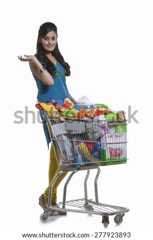 Portrait of a woman with a shopping cart - stock photo