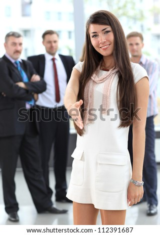 Portrait of a woman with an open hand ready to seal a deal - stock photo