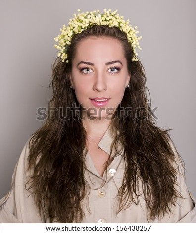 portrait of a woman with flowers. charming woman - stock photo