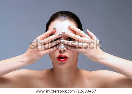 portrait of a woman with hands on face - stock photo
