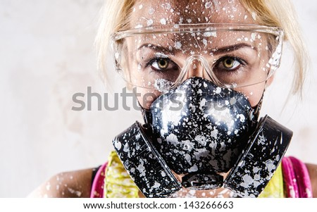 Portrait of a woman with protective filter mask - stock photo