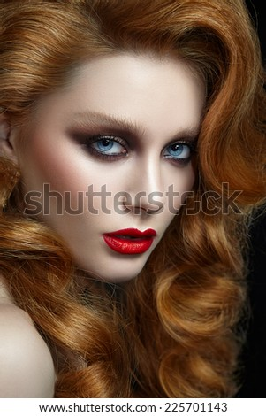 Portrait of a woman with red hair close-up - stock photo
