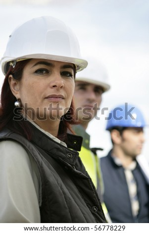 Portrait of a woman with safety helmet - stock photo