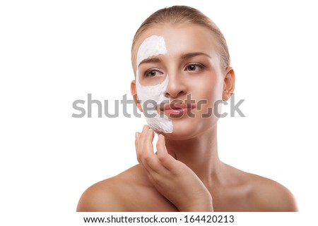Portrait of a woman with spa mask on her face. Healthcare, medicine. Isolated - stock photo