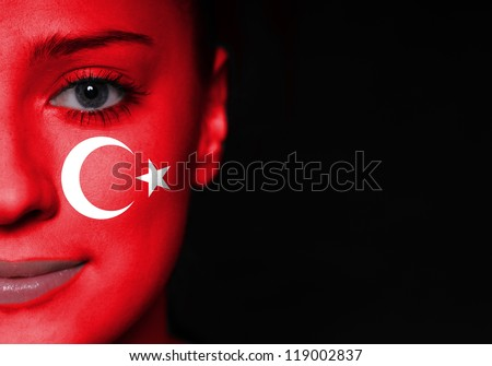 Portrait of a woman with the flag of the turkey painted on her face - stock photo