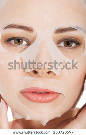 Portrait of a woman with white facial mask. - stock photo
