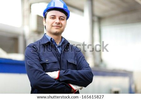 Portrait of a worker in a factory  - stock photo
