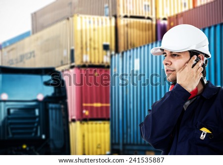 Portrait of a worker in front of a stack of containers - stock photo