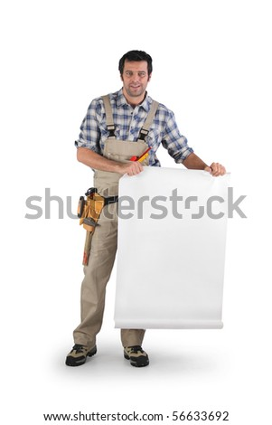 Portrait of a worker in overalls holding a white panel - stock photo