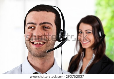 Portrait of a worker using an headset - stock photo