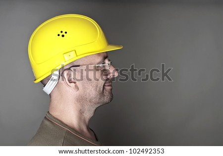Portrait of a worker with helmet - stock photo
