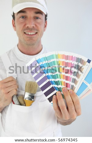 Portrait of a worker with swatches of colors - stock photo
