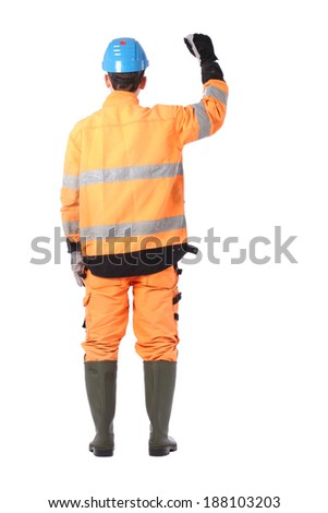 Portrait of a workman with overalls and hardhat - stock photo