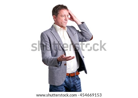 Portrait of a worried middle age man in a shirt and a jacket.