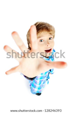 Portrait of a 9 year boy pulling his hand up. Isolated over white background. - stock photo