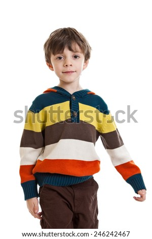 Portrait of a 6 year old boy standing wearing a sweater, waist up isolated on a white background - stock photo