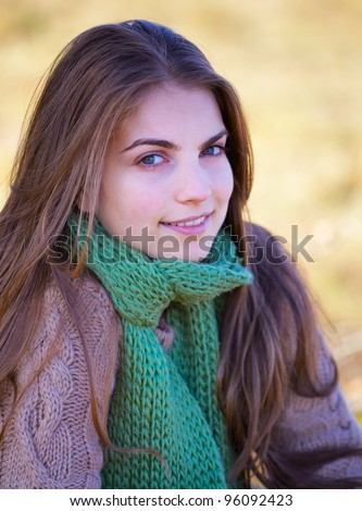 Portrait of a 20 year old woman outdoor in autumn. - stock photo