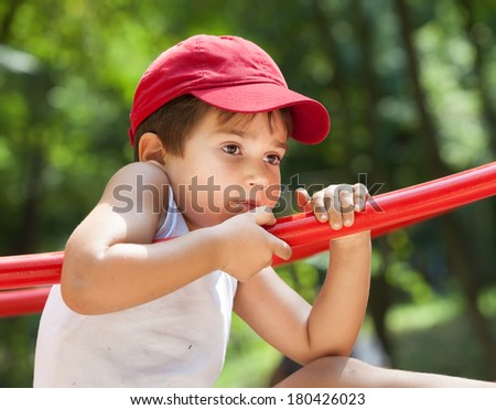 Portrait of a 3-4 years boy playing on the playground - stock photo