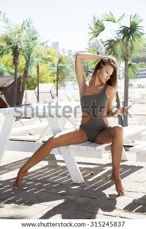 Portrait of a young adult attractive sexy and sensuality pretty beautiful brunette woman in bikini on the summer sunlight beach - stock photo