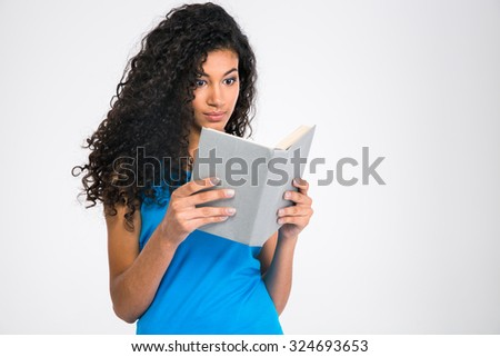 Portrait of a young afro american woman reading book isolated on a white background - stock photo