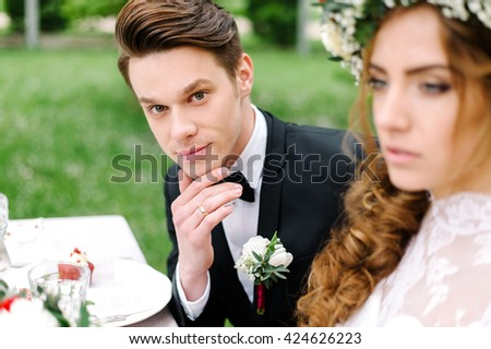 Portrait of a young and attractive groom at a wedding. Outdoor. Wedding golden ring - stock photo