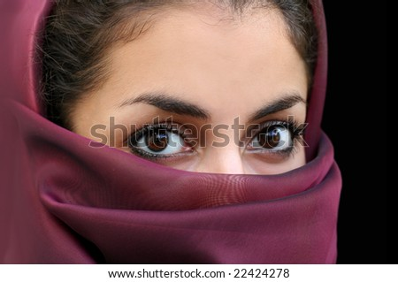 Portrait of a young arab girl in a scarf - stock photo