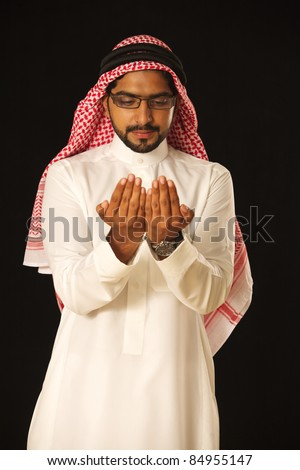 Portrait of a young Arabic doctor/sergeon isolated on black background - stock photo