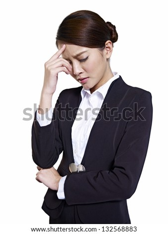 portrait of a young asian businesswoman looking depressed. - stock photo