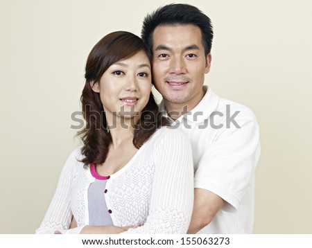 portrait of a young asian couple. - stock photo