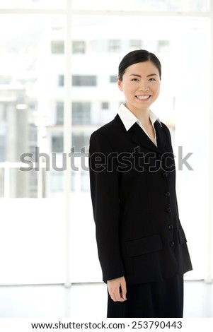 Portrait of a young Asian Woman in a lobby - stock photo