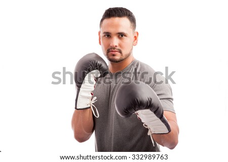 Portrait of a young attractive Hispanic boxer ready for a fight - stock photo