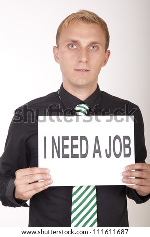 Portrait of a young attractive man holding a sign i need a job. - stock photo