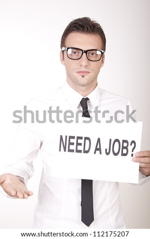 Portrait of a young attractive man holding a sign need a job?. - stock photo