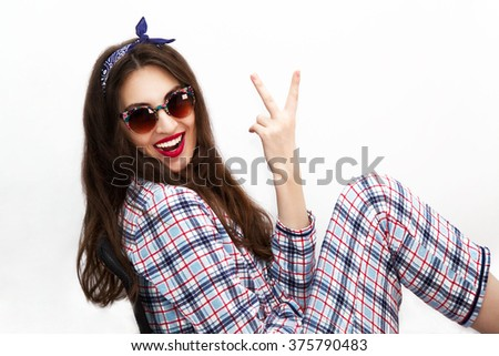Portrait of a young attractive model girl wearing pajama at home on white background. - stock photo