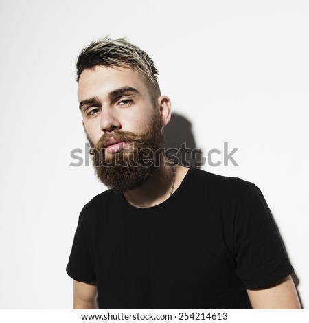 Portrait of a young bearded man on a white background - stock photo