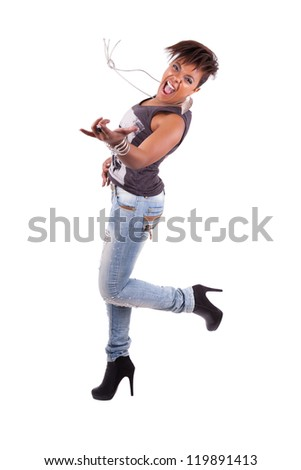 Portrait of a young beautiful black woman  playing air guitar, isolated on white background - stock photo