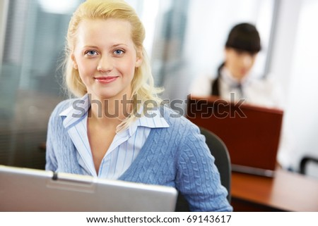 Portrait of a young beautiful businesswoman with a laptop - stock photo