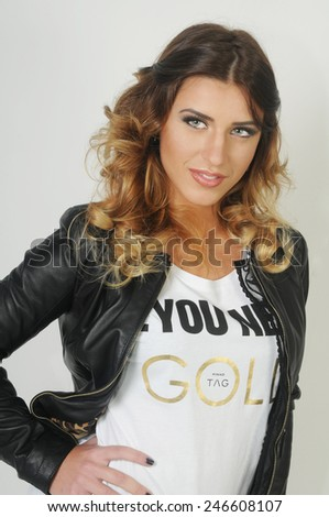 portrait of a Young beautiful caucasian teen girl wearing a White shirt and a black leather jacket - stock photo