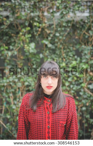 Portrait of a young beautiful caucasian woman looking in camera - freshness, serene, carefree concept - stock photo