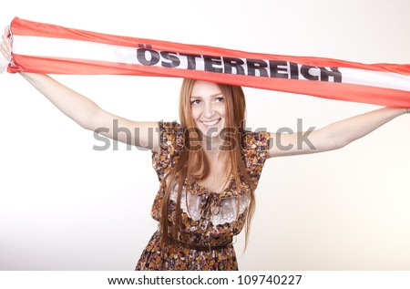 Portrait of a young beautiful female austria fan. - stock photo