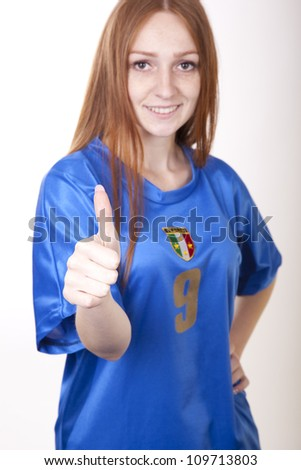 Portrait of a young beautiful female italy fan. - stock photo